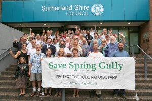 Spring Gully Supporters celebrate Council's decision to hand over the former night soil depot outside Council chambers, with Mayor Kent Johns.